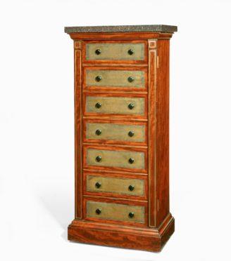 A late Regency brass-inlaid mahogany Wellington chest