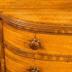 A late Regency mahogany side cabinet handles