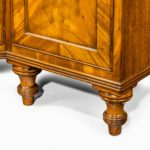 A late Regency mahogany side cabinet feet
