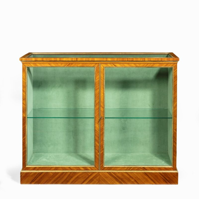 A Victorian kingwood display cabinet in French taste