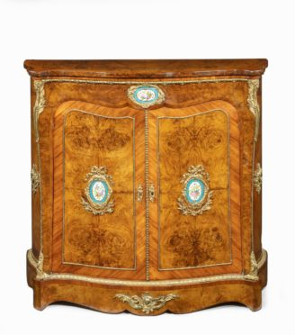 A Regency rosewood and gilt brass mounted book stand, attributed to Gillows