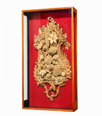 An exceptional carved lime and soft wood plaque by the carver James Peake, signed and dated 1895