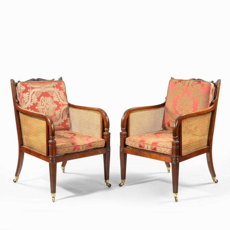 A pair of Regency mahogany bergère armchairs