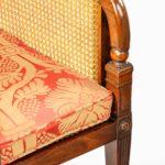Regency mahogany bergère armchairs seat detail