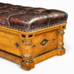 A Victorian walnut Ottoman in the Aesthetic style side