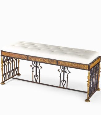 A long parcel gilt wrought iron stool attributed to Oscar Bach,