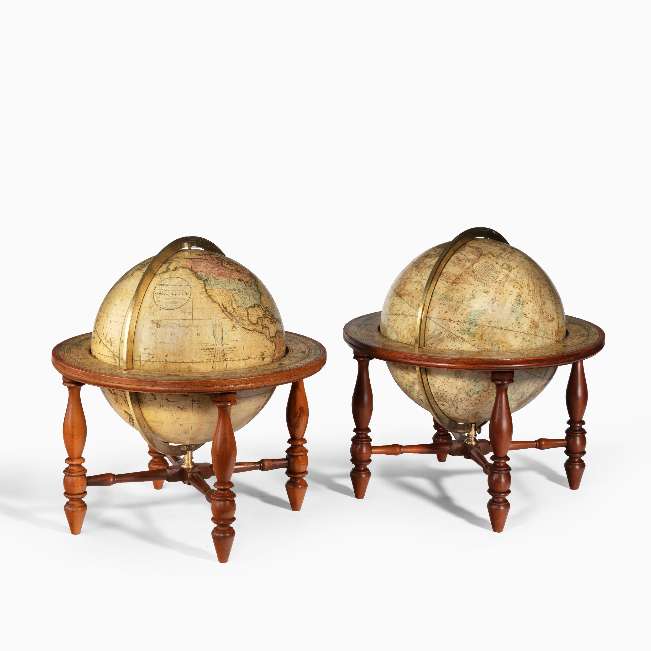 A pair of 12 inch table globes by Josiah Loring, dated 1844 and 1841