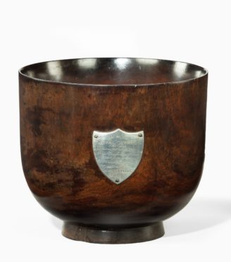A George III punch bowl made of oak from H.M.S. Royal George, 1802