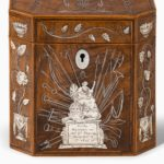 A silver-inlaid caddy commemorating the death of Admiral Lord Nelson details