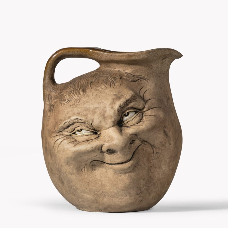 A Martinware double-sided stoneware pottery 'face' jug