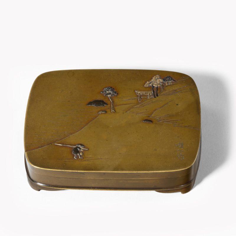 A small Meiji period mixed metal box by Tadakazu,
