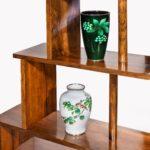 A pair of asymmetrical Art Deco walnut shelves vases display