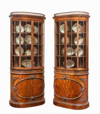 A pair of mahogany shaped display cabinets attributed to Gillows main
