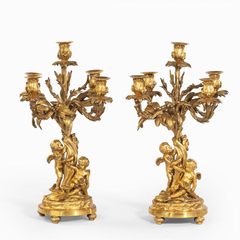 A pair of fine Napoleon III ormolu 5-branch candelabra,