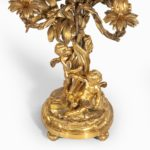 A pair of fine Napoleon III ormolu 5-branch candelabra base details