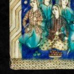 A large Qajar relief moulded pottery tile corner