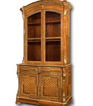 An outstanding tulipwood bureau bookcase